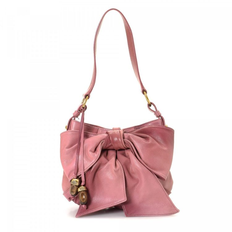 2c79320294 LXRandCo guarantees this is an authentic vintage Yves Saint Laurent Bow shoulder  bag. This practical shoulder bag was crafted in leather in pink.