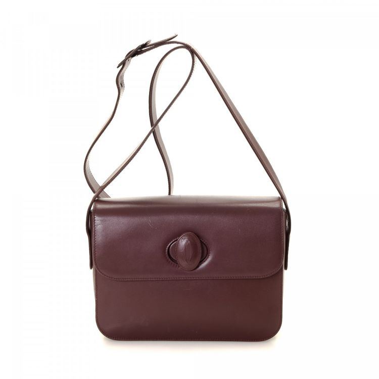 LXRandCo guarantees the authenticity of this vintage Must de Cartier  Crossbody Bag. This sophisticated saddle bag was crafted in leather in  beautiful ... 2b49876e15
