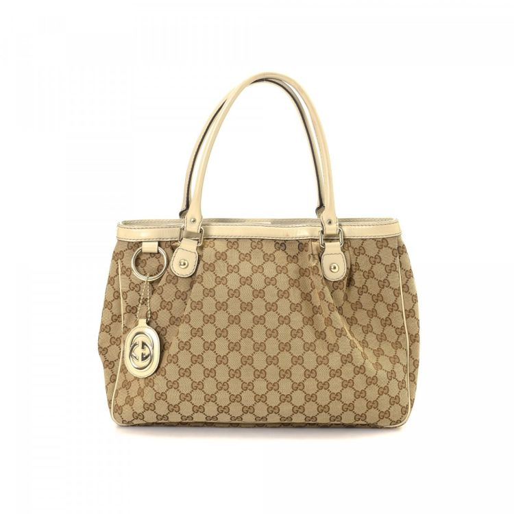 a17a008f7bb4 LXRandCo guarantees the authenticity of this vintage Gucci Sukey tote.  Crafted in gg canvas, this chic tote comes in beige. Due to the vintage  nature of ...