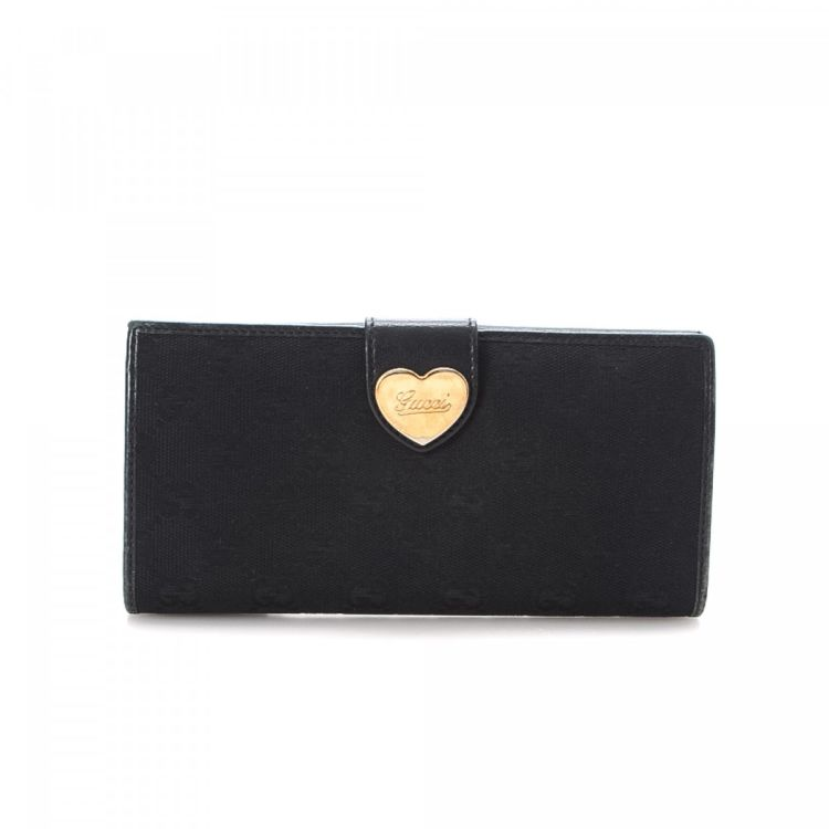 eee098ae258c LXRandCo guarantees this is an authentic vintage Gucci Heart Continental  wallet. This iconic slimfold in black is made in gg canvas.