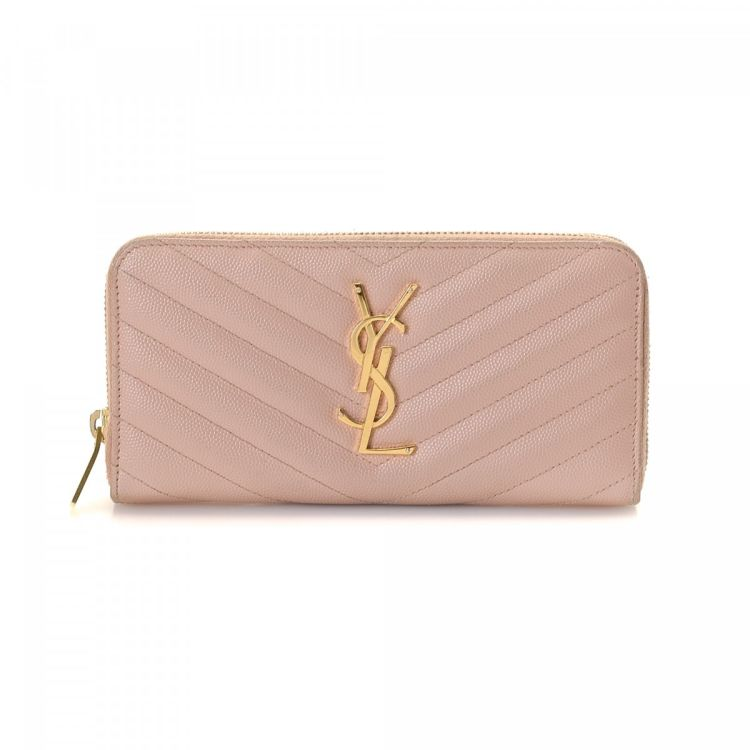 6a2b5895be2 LXRandCo guarantees the authenticity of this vintage Yves Saint Laurent Zip  Around wallet. This refined slimfold comes in light pink leather.
