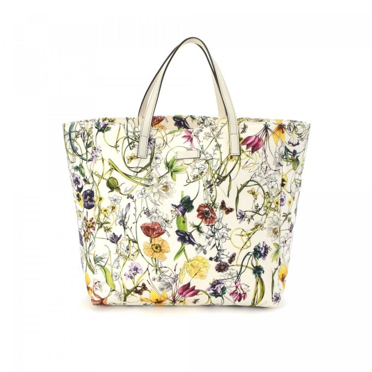25f8f43575a0 LXRandCo guarantees this is an authentic vintage Gucci tote. This classic  tote was crafted in flora canvas in multi color. Due to the vintage nature  of this ...