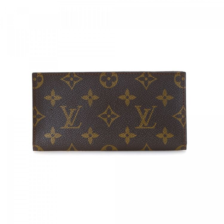 4ae92c3aea83 LXRandCo guarantees this is an authentic vintage Louis Vuitton Checkbook  Cover wallet. Crafted in monogram coated canvas