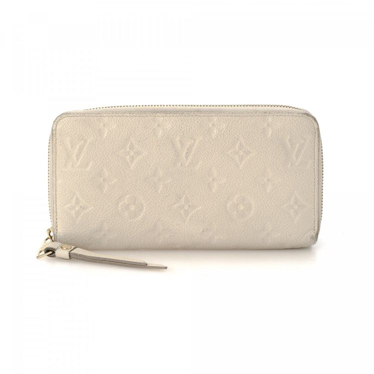 3cf11a71c514 LXRandCo guarantees the authenticity of this vintage Louis Vuitton Zippy  wallet. This elegant wallet in beautiful neige is made in monogram empreinte  ...