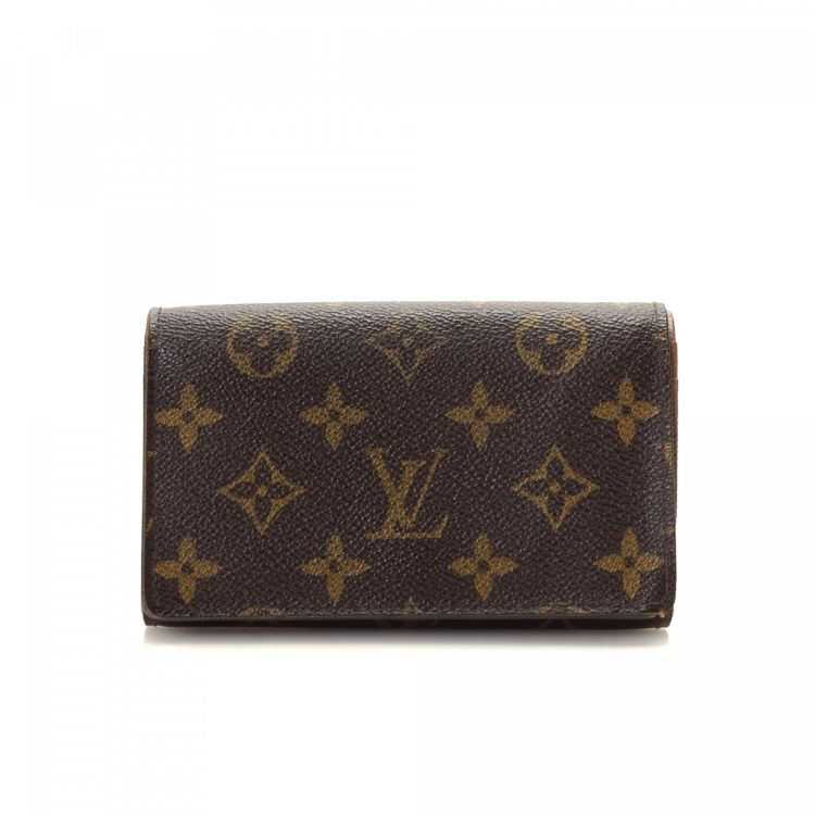 4e15eef91f1d1 LXRandCo guarantees this is an authentic vintage Louis Vuitton Porte Tresor  wallet. This luxurious slimfold in brown is made in monogram coated canvas.