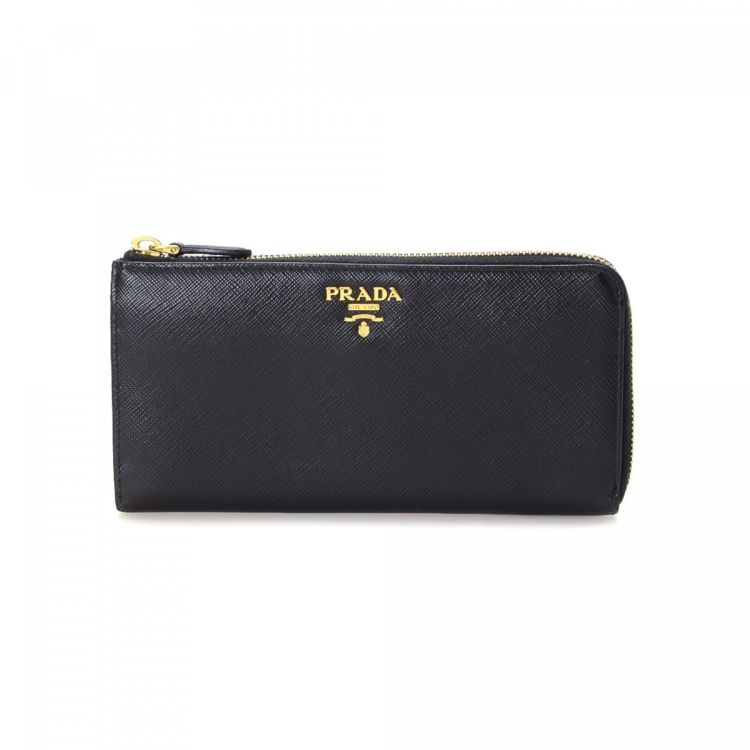 b499f0f0a4cf LXRandCo guarantees this is an authentic vintage Prada Zip wallet. This  beautiful card holder was crafted in saffiano leather in black.
