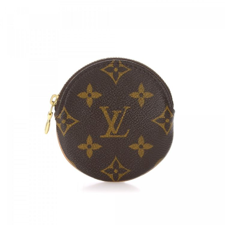 a85f1ab6c95b The authenticity of this vintage Louis Vuitton Round Coin Purse wallet is  guaranteed by LXRandCo. This classic card holder was crafted in monogram  coated ...