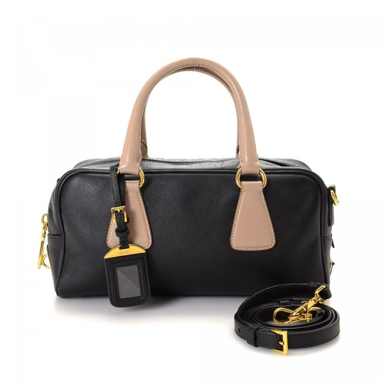c36d3afa6b92 LXRandCo guarantees the authenticity of this vintage Prada Two Way Bag  handbag. This practical pocketbook in beautiful black is made in saffiano  leather.