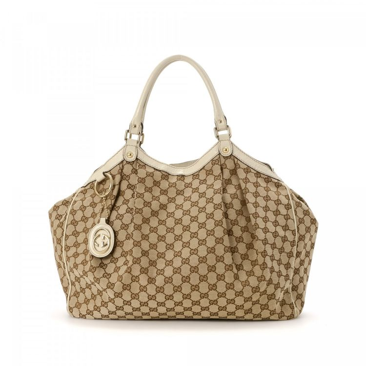 3c5748525a8d The authenticity of this vintage Gucci GG Canvas Sukey tote is guaranteed  by LXRandCo. Crafted in gg canvas, this lovely large handbag comes in  beautiful ...