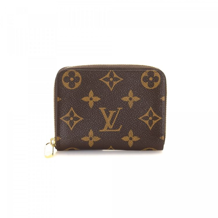 0ec011205d6c LXRandCo guarantees the authenticity of this vintage Louis Vuitton Zippy Coin  Purse wallet. Crafted in monogram coated canvas