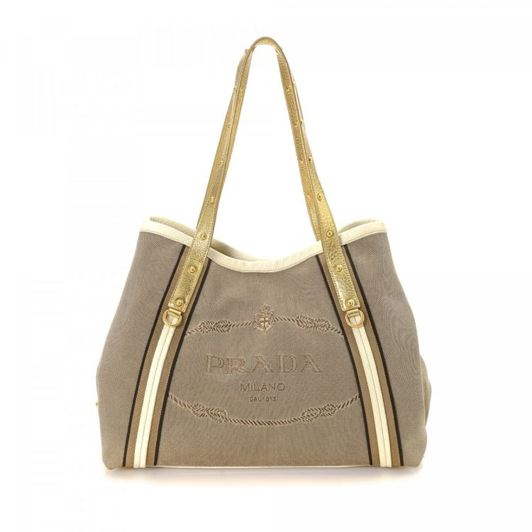 ... discount the authenticity of this vintage prada tote is guaranteed by  lxrandco. this chic bag 0f828244af253