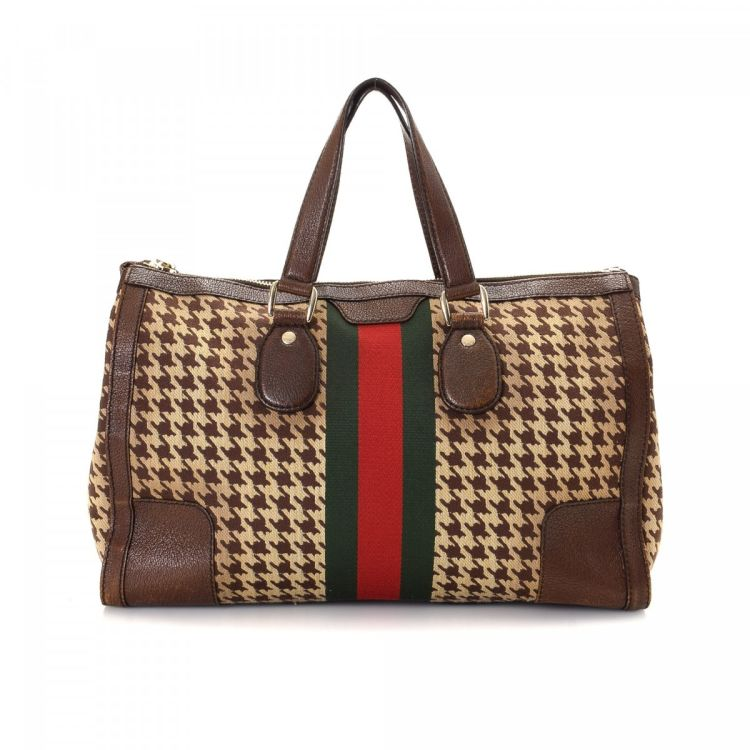 c2c2eeec173a LXRandCo guarantees the authenticity of this vintage Gucci Houndstooth Web  Joy travel bag. Crafted in canvas, this classic carry-on comes in multi  color.