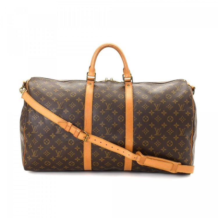 2e0b82e4c80f LXRandCo guarantees this is an authentic vintage Louis Vuitton Keepall 55  Bandouliere travel bag. This refined garment carrier was crafted in monogram  ...