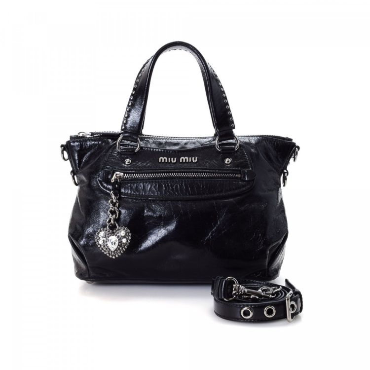 caa6cee9470 The authenticity of this vintage Miu Miu Studded Heart handbag is  guaranteed by LXRandCo. Crafted in vitello shine calf, this everyday bag  comes in black.
