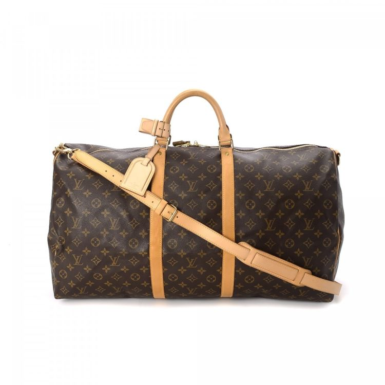 313536391c5d ... of this vintage Louis Vuitton Keepall 60 Bandouliere travel bag. This  exquisite duffel bag was crafted in monogram coated canvas in beautiful  brown.