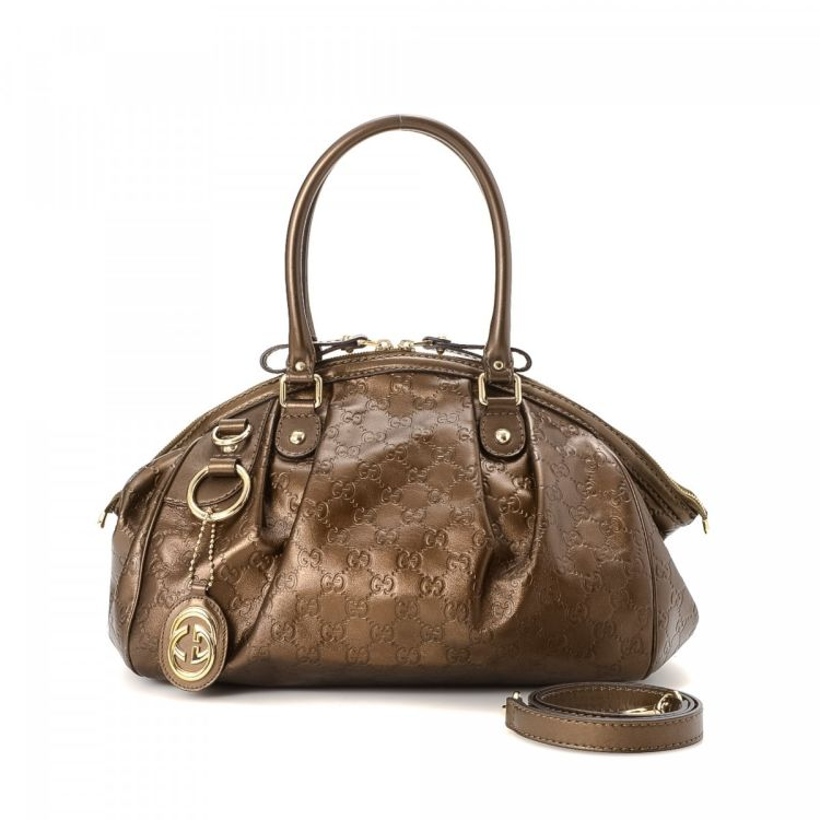 Crafted In Guccissima Leather This Luxurious Purse Comes Metallic Bronze Due To The Vintage Nature Of