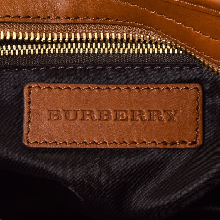 LXRandCo guarantees this is an authentic vintage Burberry Studded Heart Two  Way Bag handbag. This iconic bag was crafted in leather in beautiful brown. 3d55f91046fcb