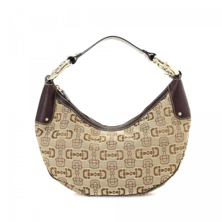 ac6160b9e LXRandCo guarantees this is an authentic vintage Gucci Hobo Bag shoulder bag.  Crafted in horsebit canvas, this beautiful pocketbook comes in beige.