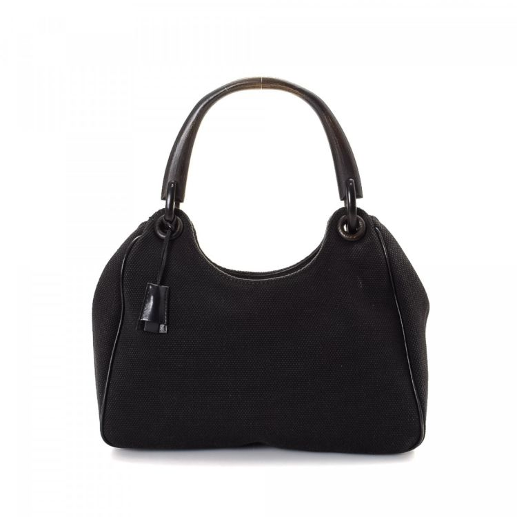 adab5b70a104f9 LXRandCo guarantees the authenticity of this vintage Gucci Wooden Handle  Hobo Bag shoulder bag. This refined bag comes in black canvas.