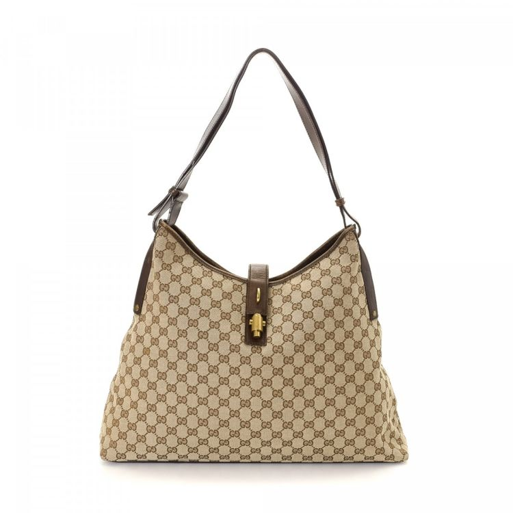 8ca529c9f72 LXRandCo guarantees the authenticity of this vintage Gucci GG shoulder bag.  This iconic bag comes in brown canvas. Due to the vintage nature of this  product ...