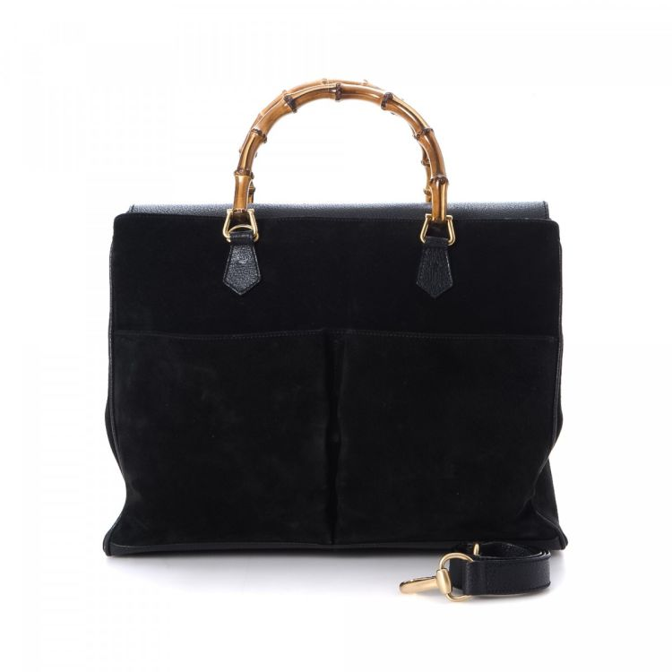 e69022600ac LXRandCo guarantees this is an authentic vintage Gucci Two Way tote.  Crafted in bamboo suede