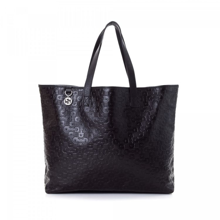490f34d8163 LXRandCo guarantees this is an authentic vintage Gucci tote. This exquisite  work bag was crafted in horsebit leather in dark brown.