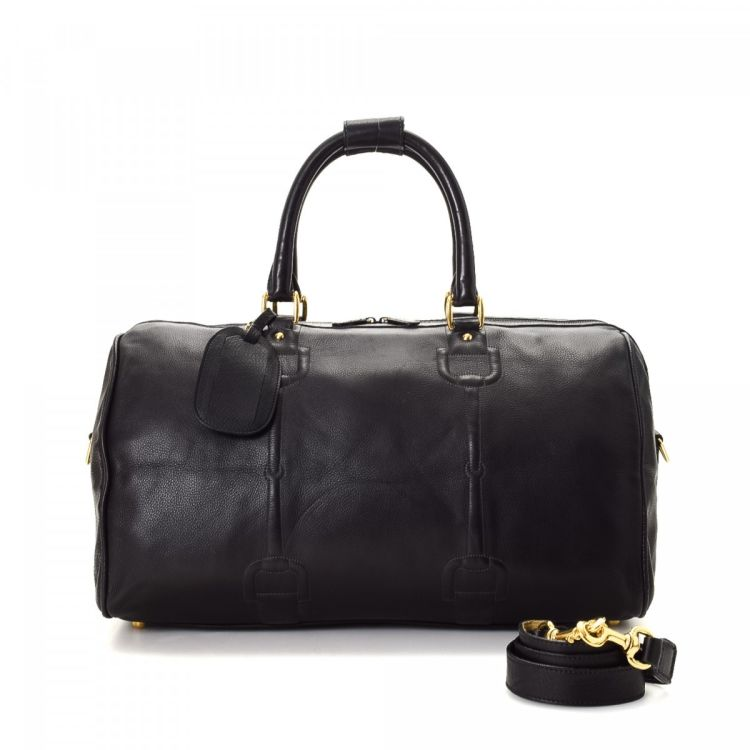 ed34f1f340a3 LXRandCo guarantees this is an authentic vintage Gucci Horsebit Leather  travel bag. Crafted in horsebit leather, this luxurious carryall comes in  black.