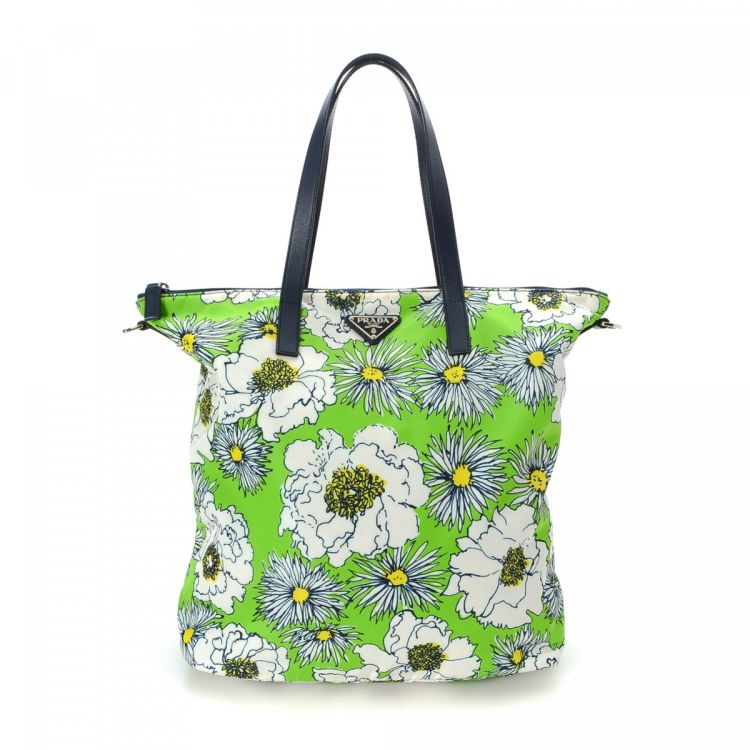 ee5ef47190 LXRandCo guarantees the authenticity of this vintage Prada Flower Print tote.  This beautiful tote bag in green is made in tessuto nylon.