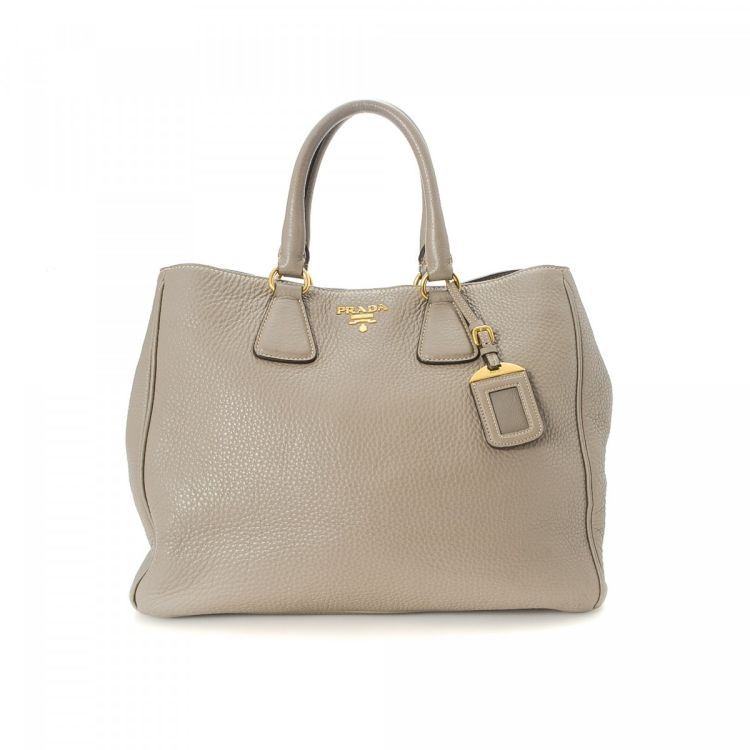 928082a6b19d3 LXRandCo guarantees this is an authentic vintage Prada Vitello Bag tote.  This practical tote bag in taupe is made in vitello daino leather.