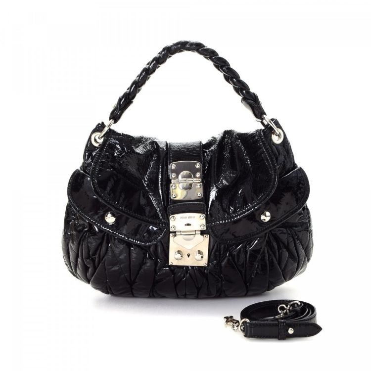 b72dfa604931 LXRandCo guarantees this is an authentic vintage Miu Miu Coffer Two Way Bag  handbag. This luxurious bag was crafted in patent leather in beautiful black .