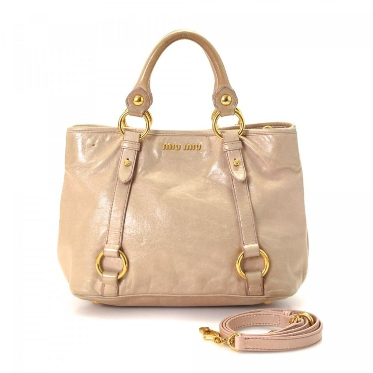 LXRandCo guarantees this is an authentic vintage Miu Miu Two Way handbag.  This stylish bag was crafted in leather in beautiful pale pink. 08d8a8005de65