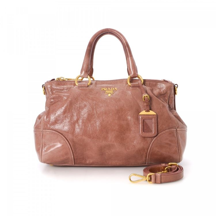 dc6bb602b1ae LXRandCo guarantees the authenticity of this vintage Prada Two Way Bag  shoulder bag. Crafted in leather, this beautiful pocketbook comes in pink.