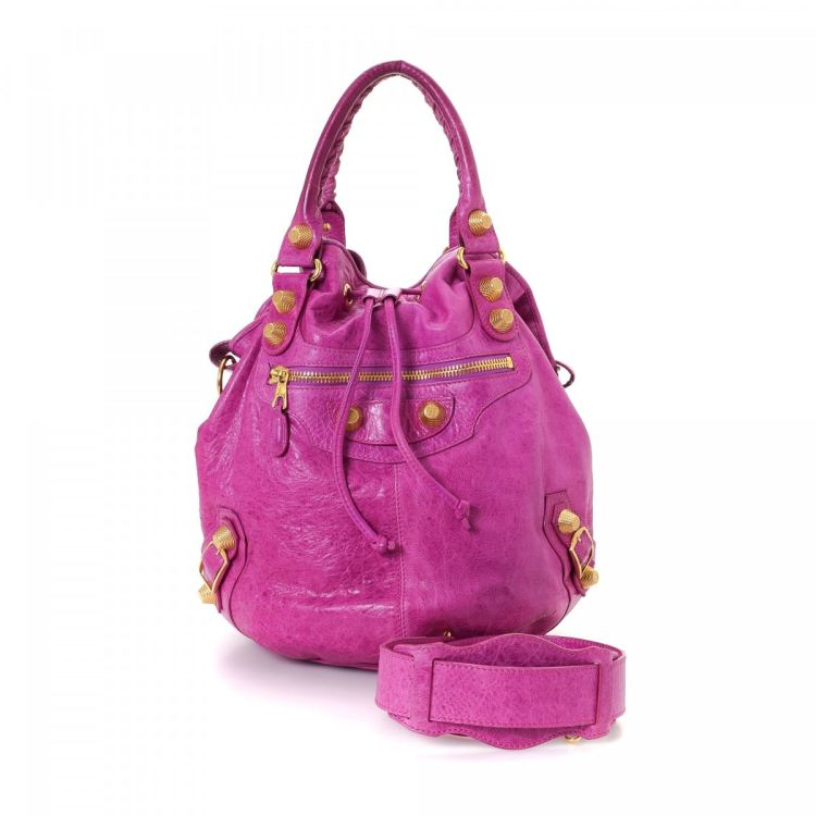 7e859e930fd7 The authenticity of this vintage Balenciaga Giant Pompon shoulder bag is  guaranteed by LXRandCo. This exquisite pocketbook in beautiful magenta is  made in ...
