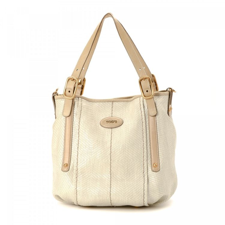 720c3e50ca24 LXRandCo guarantees this is an authentic vintage Tod's G-Line Easy Two Way  tote. This exquisite tote was crafted in raffia in cream.