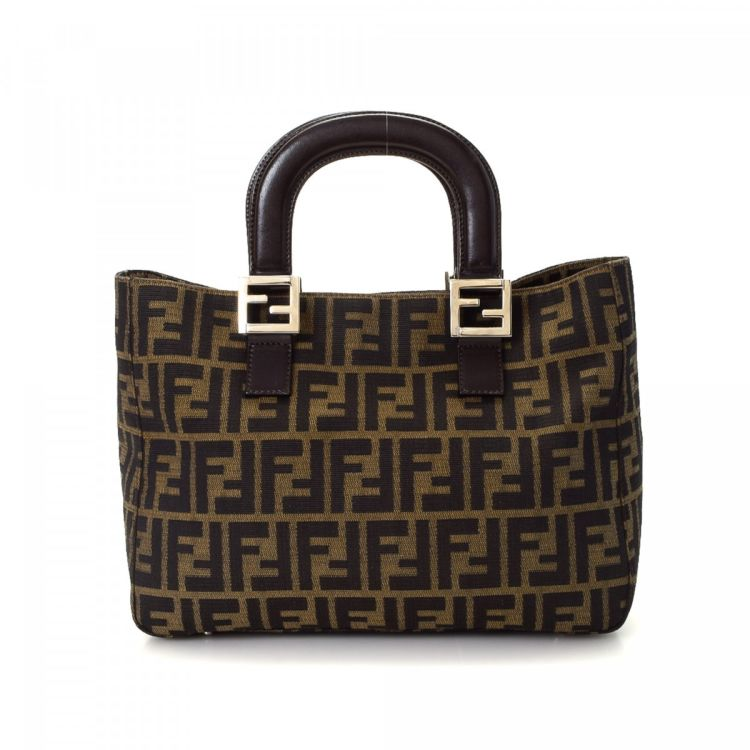 21a27bf9ab4e The authenticity of this vintage Fendi handbag is guaranteed by LXRandCo.  Crafted in zucca canvas