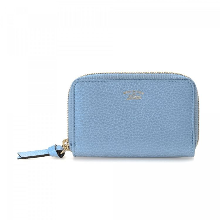 39036d94f12d55 LXRandCo guarantees the authenticity of this vintage Gucci Zip Around Coin Purse  wallet. This signature bifold in light blue is made of leather.
