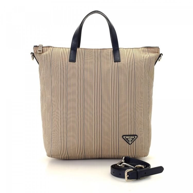 c8a6e8f402e5 LXRandCo guarantees this is an authentic vintage Prada Striped Two Way tote.  Crafted in tessuto nylon