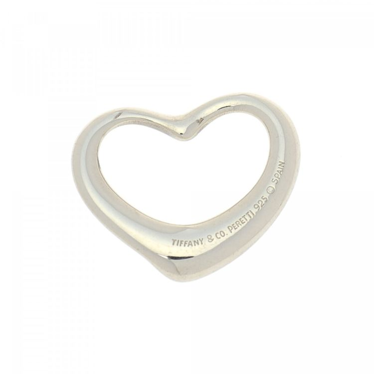 f4dd0f765 The authenticity of this vintage Tiffany Elsa Peretti Open Heart pendant is  guaranteed by LXRandCo. Crafted in 925 silver, this everyday bag charm  comes in ...