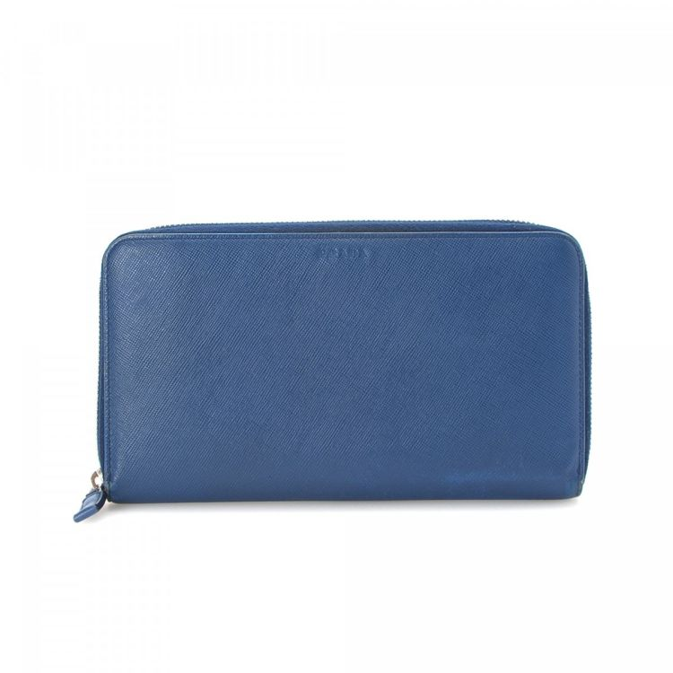 9601bbb9b186 LXRandCo guarantees the authenticity of this vintage Prada Zip Around  Organizer wallet. This exquisite bifold in blue is made in saffiano leather.