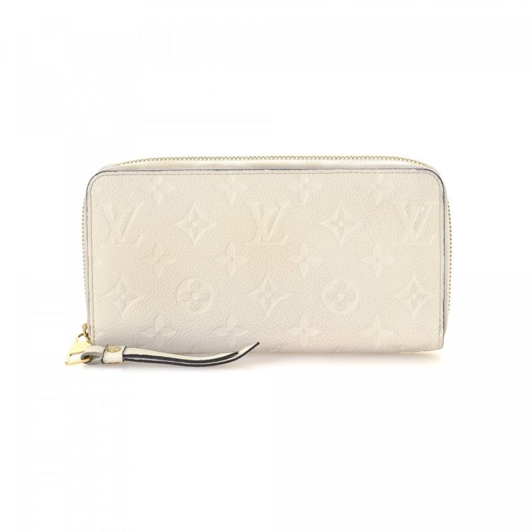 3fb6bd6605cc LXRandCo guarantees this is an authentic vintage Louis Vuitton Zippy wallet.  This practical coin purse in neige is made in monogram empreinte leather.