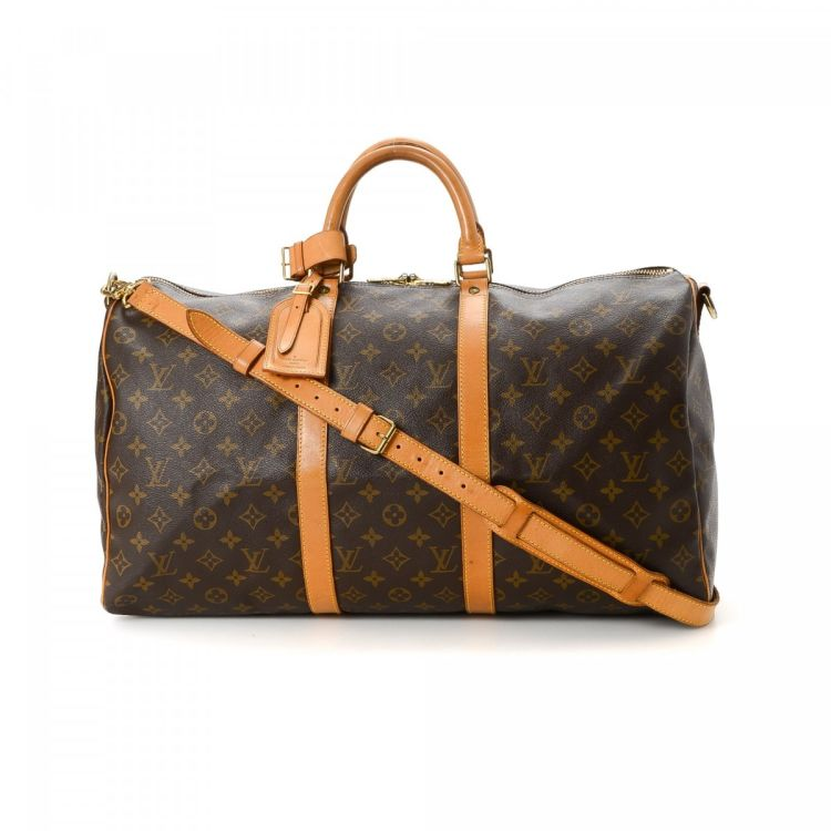 LXRandCo guarantees this is an authentic vintage Louis Vuitton Keepall 50  Bandouliere travel bag. This iconic duffel bag in brown is made in monogram  coated ... 1cdd681bc8f1d