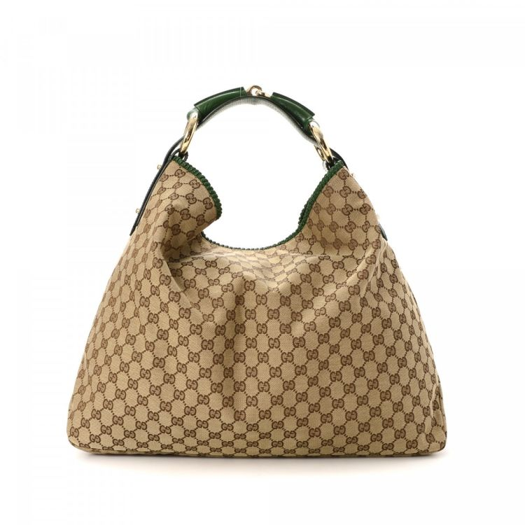 8b57aea96 LXRandCo guarantees this is an authentic vintage Gucci Horsebit Hobo Bag  shoulder bag. This iconic shoulder bag was crafted in gg canvas in beige.