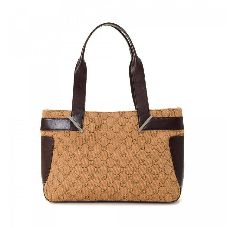 cbbdc543638 LXRandCo guarantees this is an authentic vintage Gucci tote. Crafted in gg  canvas