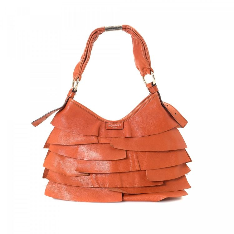 7719b00e08 LXRandCo guarantees this is an authentic vintage Yves Saint Laurent  shoulder bag. This refined shoulder bag comes in orange leather.