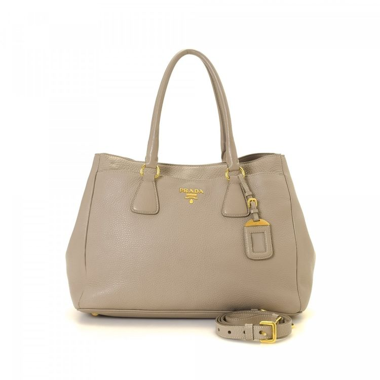 7f97ee426b98 LXRandCo guarantees this is an authentic vintage Prada Two Way Bag tote.  This elegant tote bag in beautiful beige is made of leather.