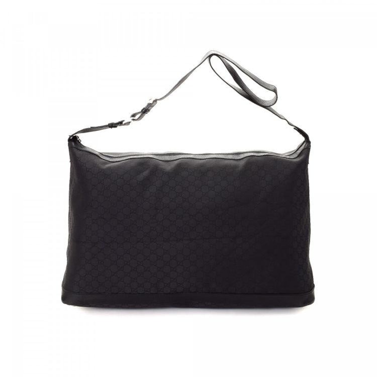 c2c3e6672a7e LXRandCo guarantees this is an authentic vintage Gucci travel bag. Crafted  in guccissima nylon, this lovely duffel bag comes in beautiful black.