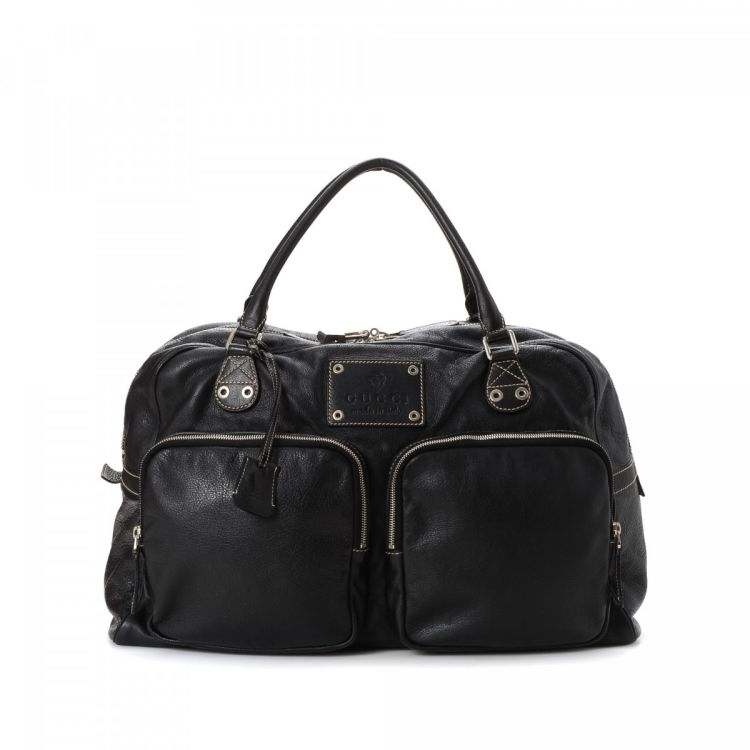 940b8457144c LXRandCo guarantees this is an authentic vintage Gucci Crest travel bag.  This iconic duffel bag in beautiful black is made of leather.