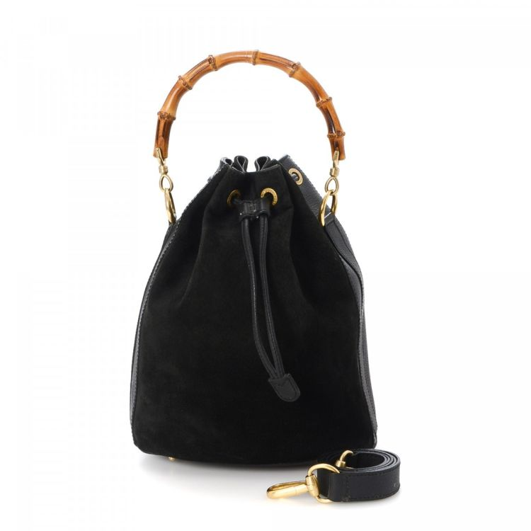 9803d2baae1024 The authenticity of this vintage Gucci Bamboo Two Way Bag shoulder bag is  guaranteed by LXRandCo. This classic purse in beautiful black is made of  leather ...