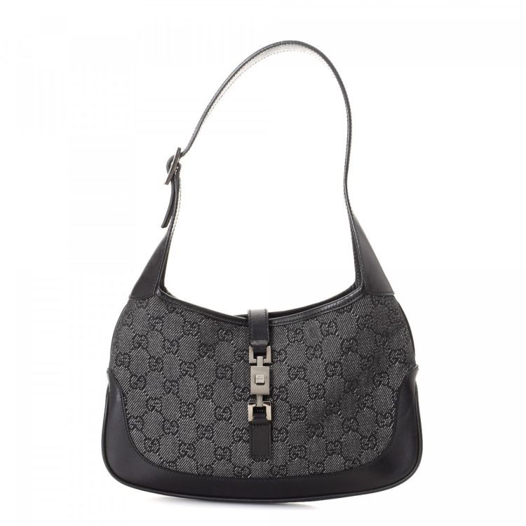 af3861ecd4d LXRandCo guarantees the authenticity of this vintage Gucci Jackie handbag.  This iconic purse was crafted in gg canvas in grey. Due to the vintage  nature of ...
