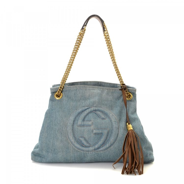 f73118b797c LXRandCo guarantees this is an authentic vintage Gucci Soho shoulder bag.  This stylish shoulder bag in light blue is made of denim. Due to the vintage  ...